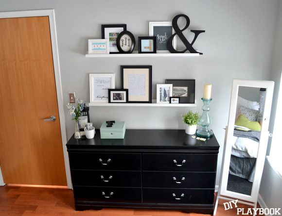 Picture frame wall using shelves instead of hanging everything #DecorByMe @ForRent.com