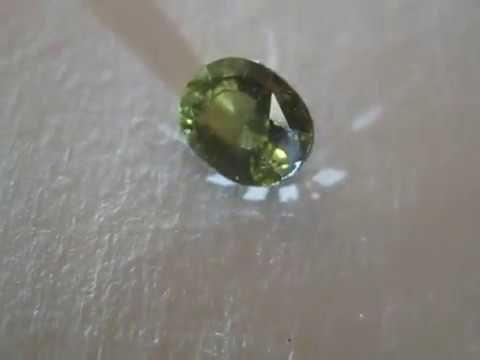 Batu Permata Alami Zircon Brownish Yellow Oval Cut 1.86 carat