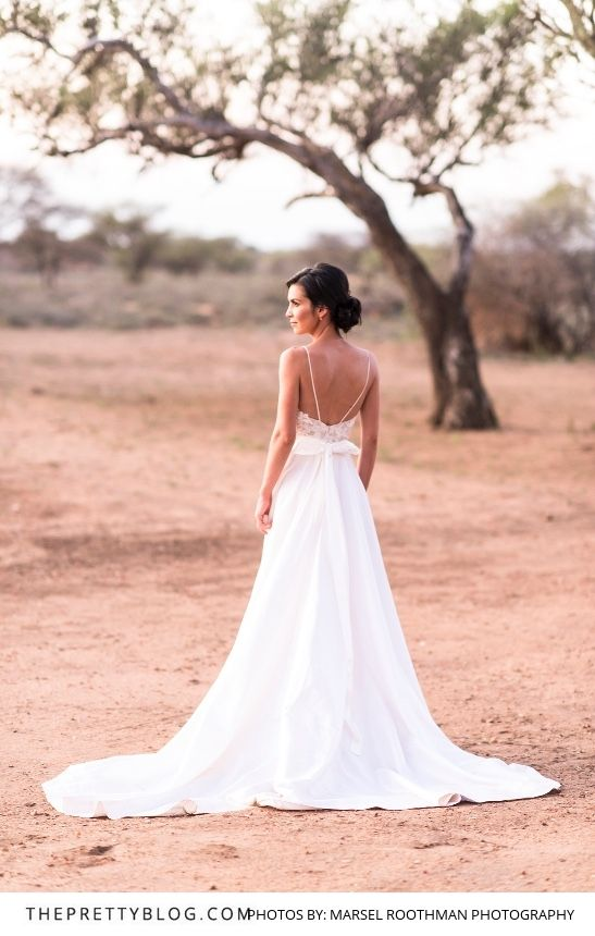 A beautiful wedding dress by Kobus Dippenaar for this bushveld wedding celebration at Bordeaux Game Farm | Photograph by Marsel Roothman | http://www.theprettyblog.com/wedding/handmade-delicate-an-all-natural-bushveld-celebration/