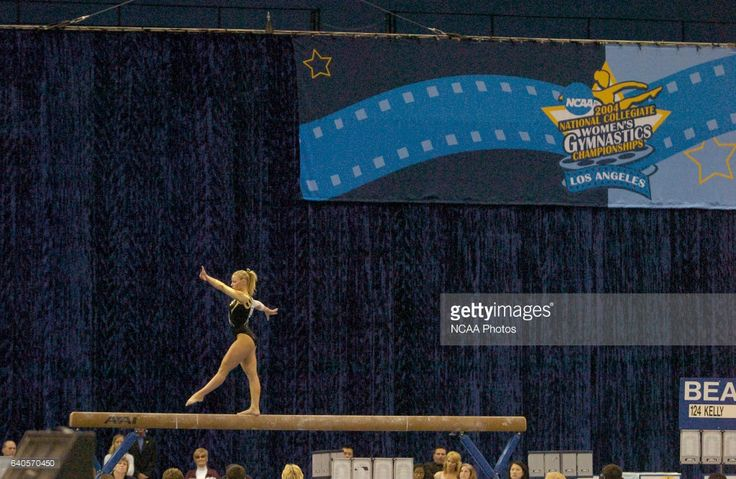Ashley Kelly of the Arizona State University competes on the Balance Beam during the 2004 NCAA Women's Gymnastics Championships held at Pauley Pavilion on the campus of the University of California - Los Angeles in Los Angeles, CA. Kelly placed first in the event to win the national title. ©Brett Wilhelm/NCAA Photos via Getty Images