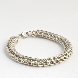 Hand crafted heavy gauge men's chain maille bracelet by Laura McIvor (Calgary, AB). Member of the Alberta Craft Council.