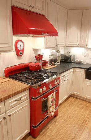 There you go! White cabinets and red appliances that give character and a punch of color to the kitchen.