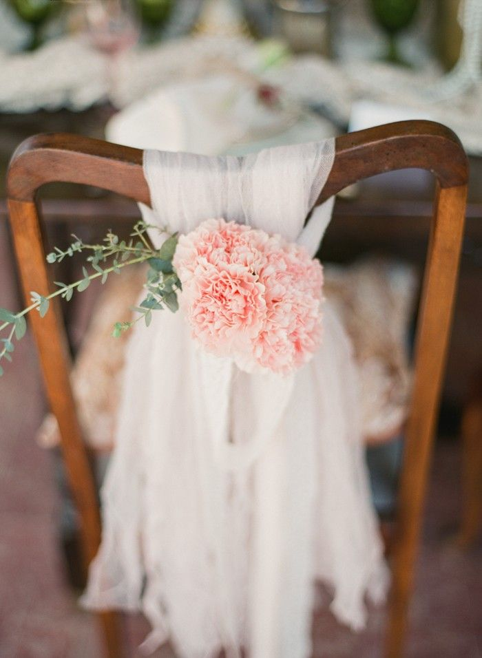 From a Vintage weddings, a wonderful wooden chair is decorated with a strip of lace with pastel pink flowers wrapped to create the wedding chair decor. So cute, I love it~