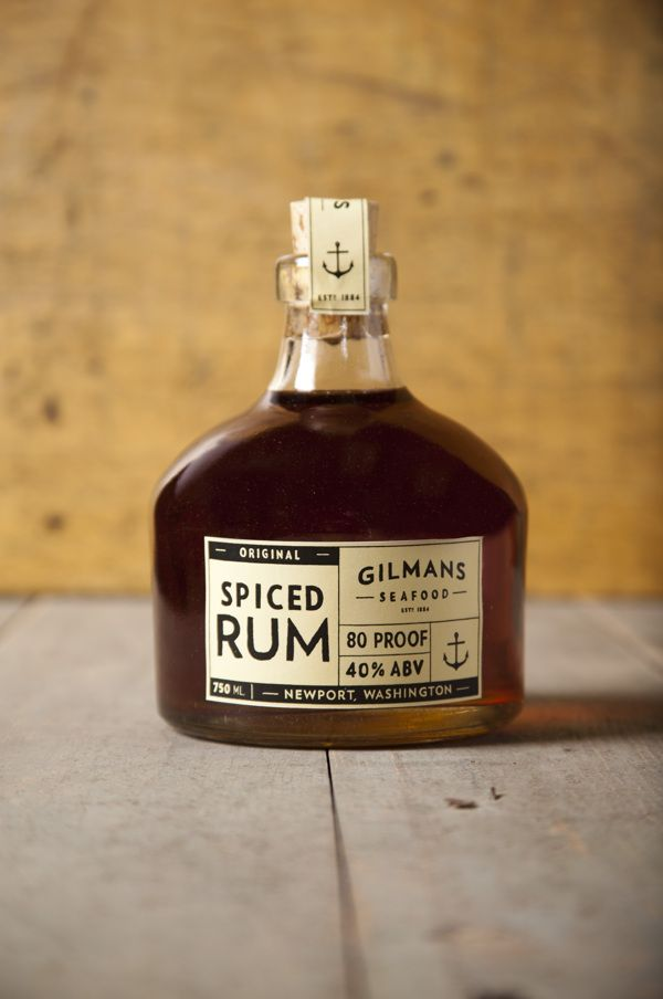 Spiced Rum Branding. Feels like a rugged sailor would drink this. Great label design and unique bottle shape.