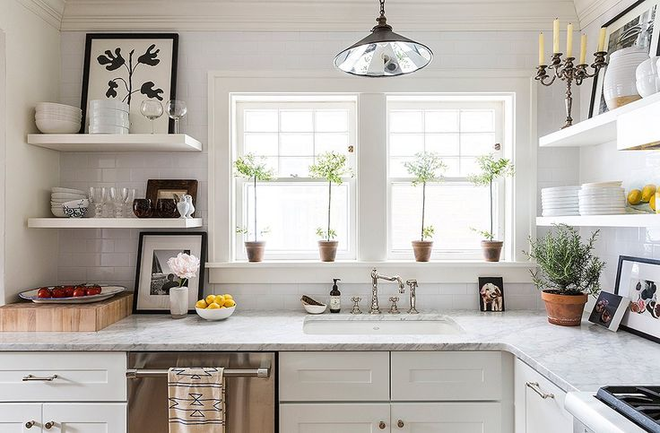 The kitchen and the master bath, which hadn't been remodeled since the '50s, were both gut-renovated with whitewashed wood, carrara marble and white subway tiles.