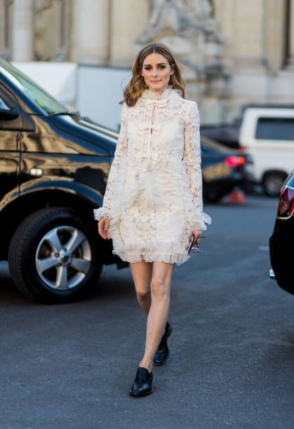 Olivia Palermo wearing a creme dress outside Giambattista Valli during Paris Fashion Week Haute Couture Fall/Winter 20172018 Day Two on July 3 2017...