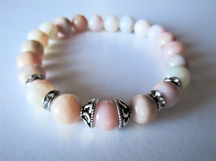 Peruvian Pink Opal stretch bracelet with sterling silver bead cups. Handmade in Canada. Stone of love, great bridal gift or valentines gift.