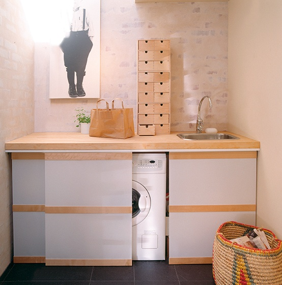 ann idstein® | Panel System | Textile partition system hiding a washing machine | Private residence