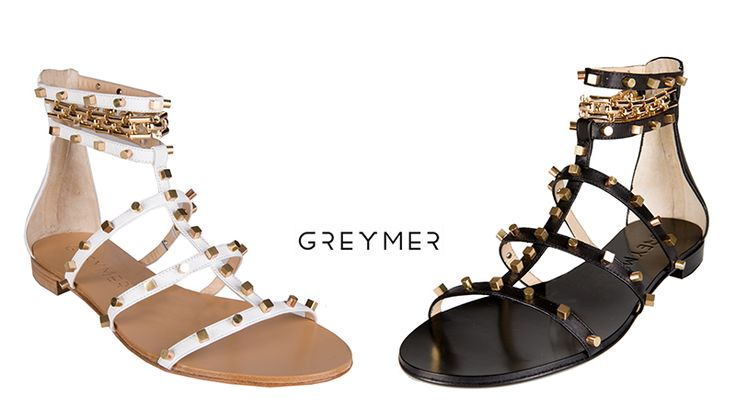 black or white? Glamorous and simple calfskin flat sandal with chain accessory and metal studs in different sizes. www.greymer.it