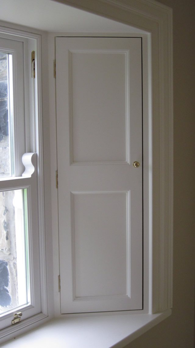 Traditional timber sash window shutters