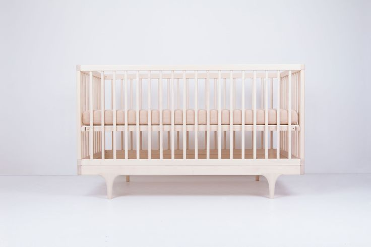 Solid wood crib that plays with classic form and contemporary, ultra-bold colors. Inspired by the storybook circus wagon, the Caravan Crib is made start to finish in the USA and almost entirely by hand.
