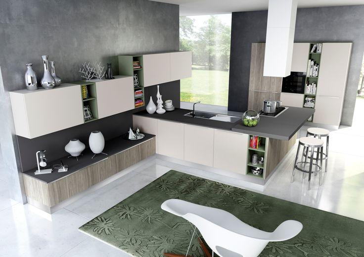 elementi a giorno e complementi di arredo di colore verde completano la cucina PISA