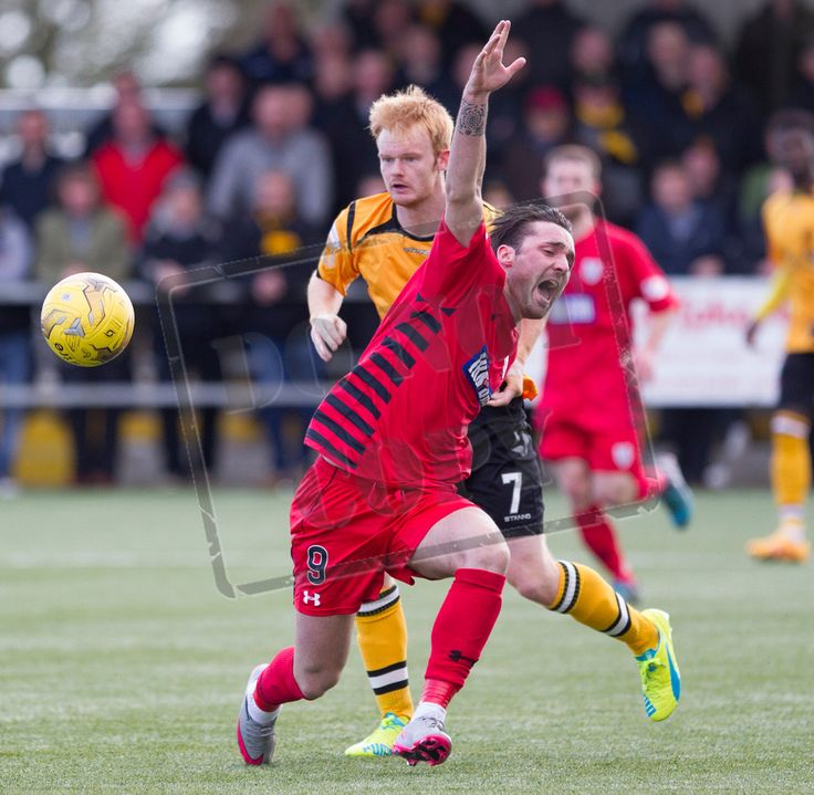 Queen's Park's Chris Duggan is brought down during the SPFL League Two game between Annan Athletic and Queen's Park.