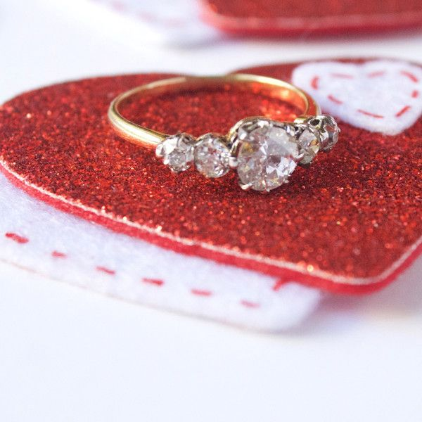 Arielle is a lovely mid-century 5 stone vintage diamond engagement ring set in yellow gold.