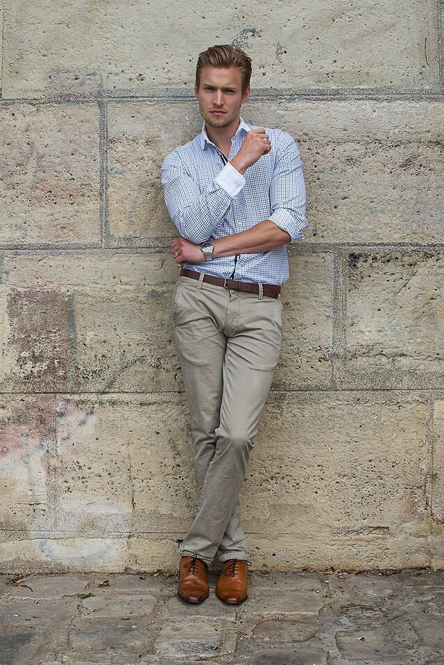 Shop this look on Lookastic:  https://lookastic.com/men/looks/dress-shirt-chinos-oxford-shoes-belt-watch/12463  — Light Blue Gingham Dress Shirt  — Silver Watch  — Dark Brown Leather Belt  — Grey Chinos  — Brown Leather Oxford Shoes