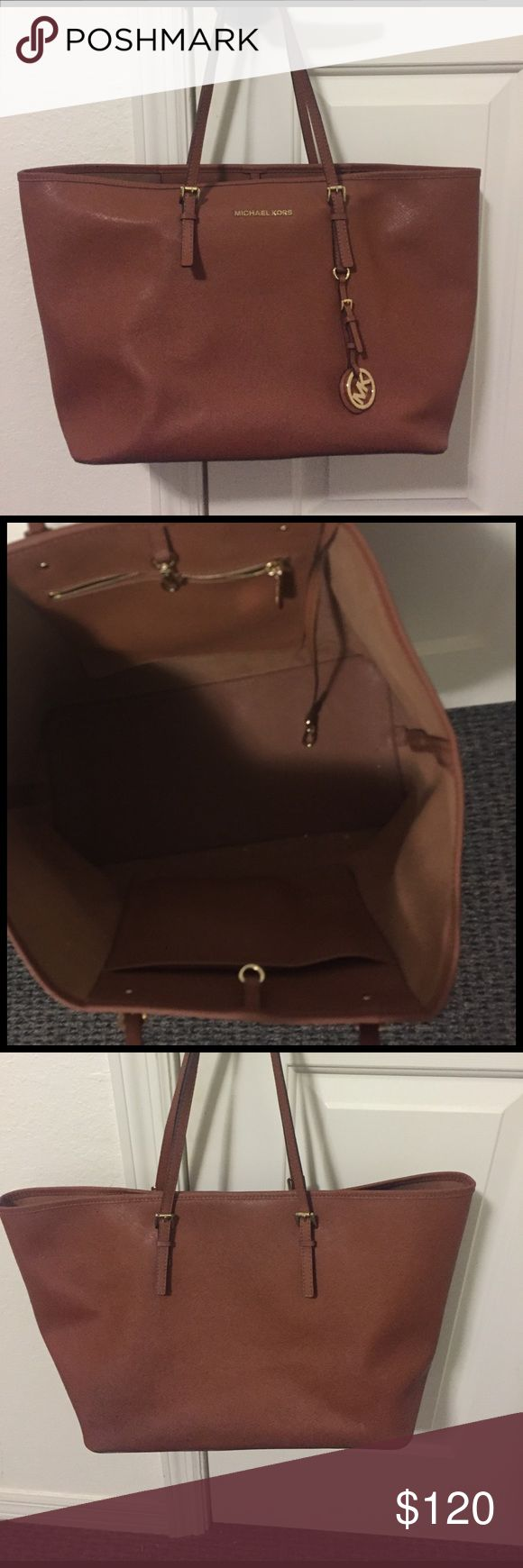 Large Michael Kors Jet Set Tote A large luggage color Michael Kors purse. In great condition. Michael Kors Bags Totes