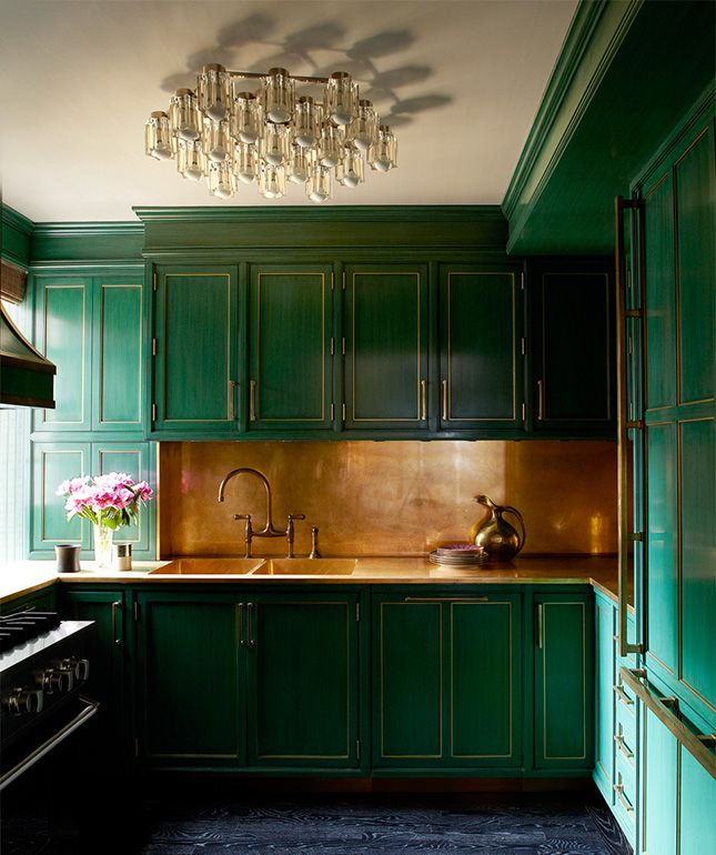 Who wouldn't want to cook in this beautiful emerald kitchen?