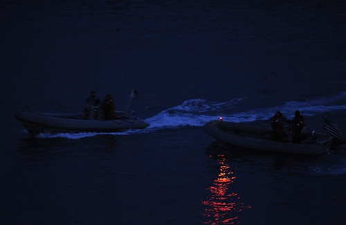 BUSAN, Republic of Korea (March 18, 2010) Sailors assigned to the U.S. 7th Fleet command ship USS Blue Ridge (LCC 19) conduct nighttime small-boat attack force protection drills in the harbor of Busan, Republic of Korea. (U.S. Navy photo by Mass Communication Specialist 3rd Class Daniel Viramontes/Released)