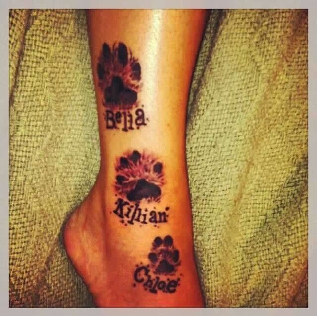 Paw print tattoo. love the placement!