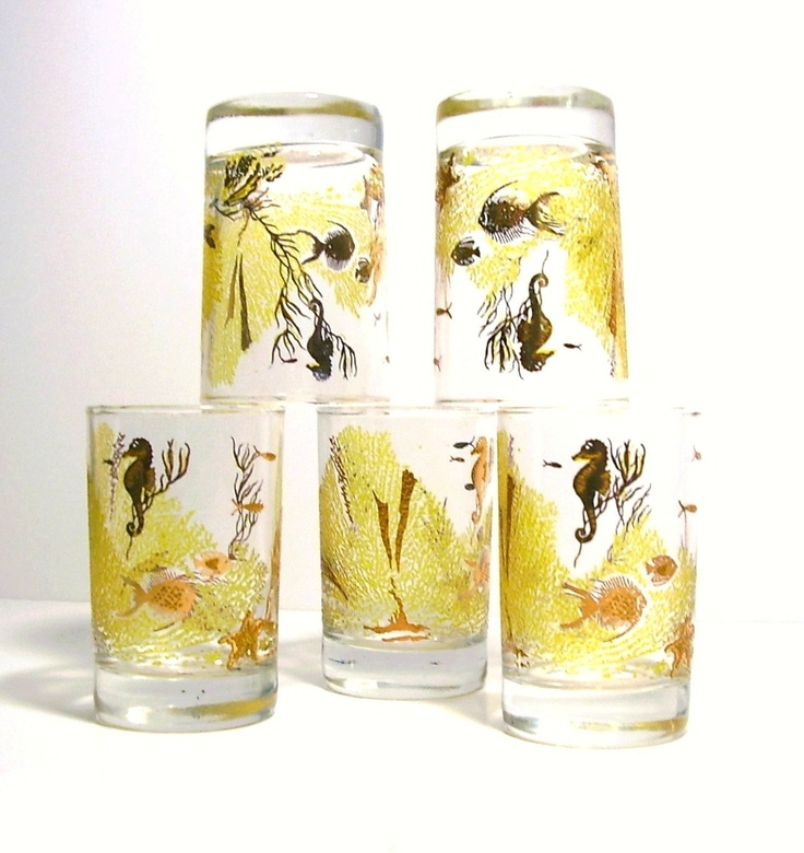Vintage Mid Century Bar ware Nautical Gold and Yellow Cocktail Glasses Set of 5. $34.00, via Etsy.
