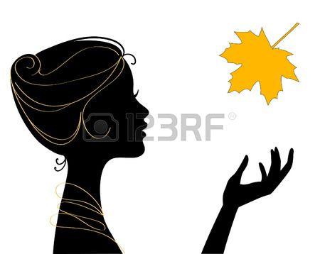 silueta de mujer hermosa con hojas  Foto de archivo