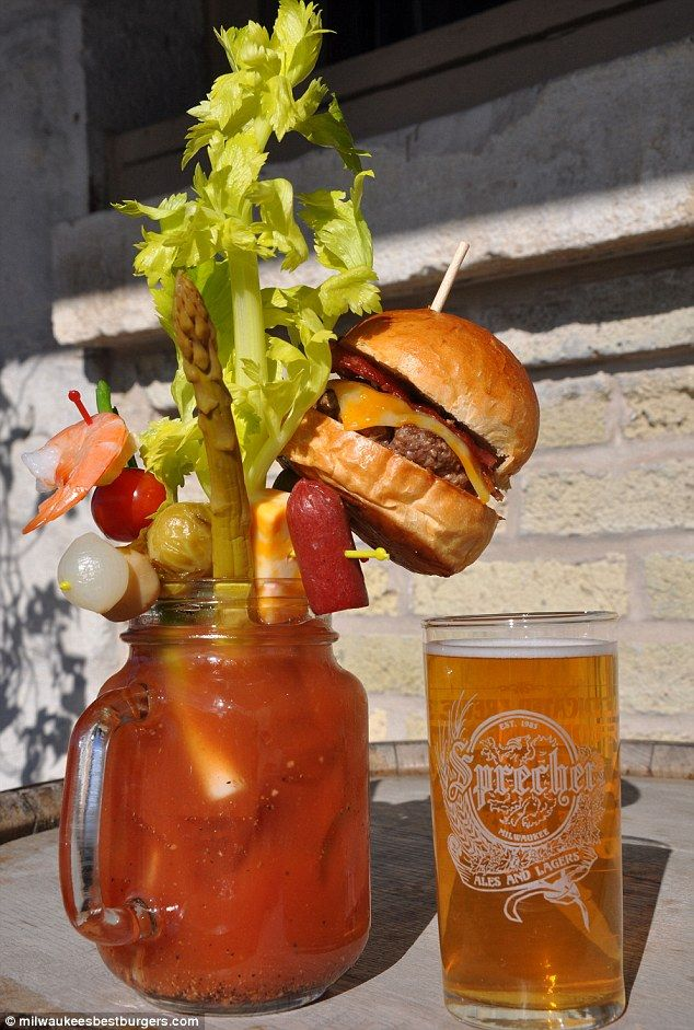 Super snack: Sobelman's Pub & Grill in Milwaukee has been inundated after putting the 'fully loaded cheeseburger Bloody Mary' with a chaser of Sprecher beer - all for $9 - on the menu.  Oh Wisconsin...