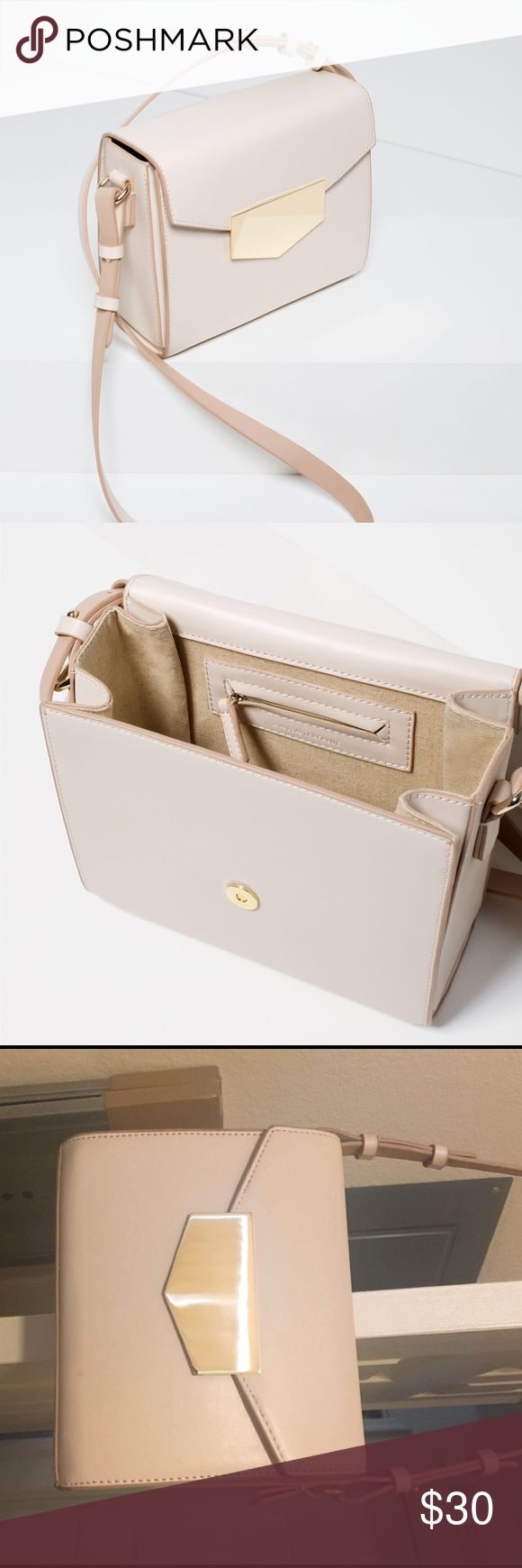 Zara Crossbody Bag with Metallic Closure Ecru Medium sized Crossbody Bag. This bag has only been used a couple times and is in excellent condition! Off white color. According to Zara, the color of the bag is Ecru. Zara Bags Crossbody Bags