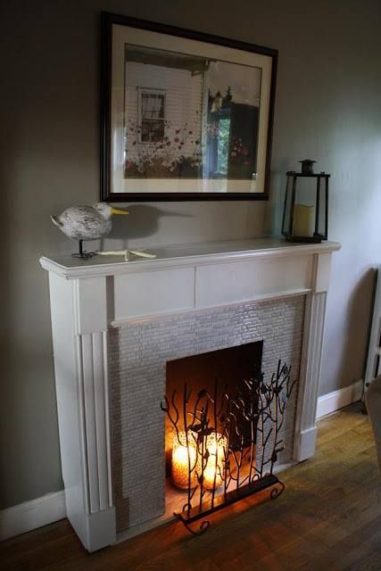 Smart Tiles are not only beautiful as a kitchen or bathroom backsplash. Here, we have Elizabeth's faux fireplace and our Bellagio Marmo.