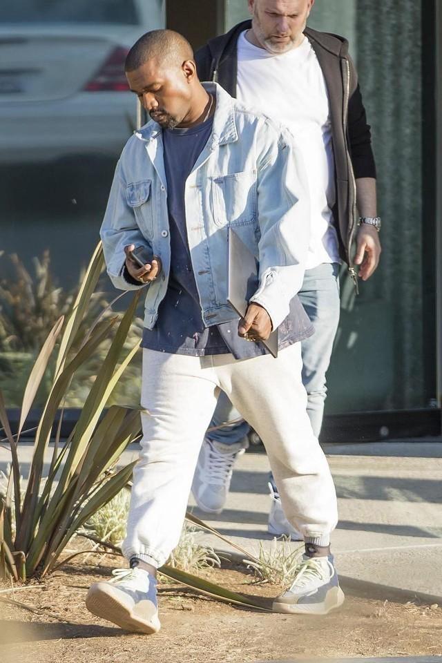 Kanye West wearing a blue Yeezy Worker Jean Jacket