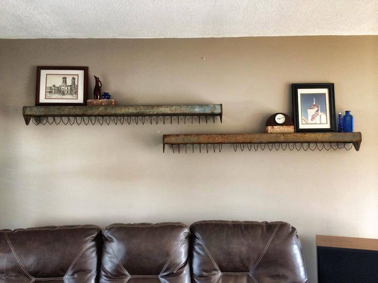 Chicken feeders as wall shelves. Follow us on Facebook for more great ideas!