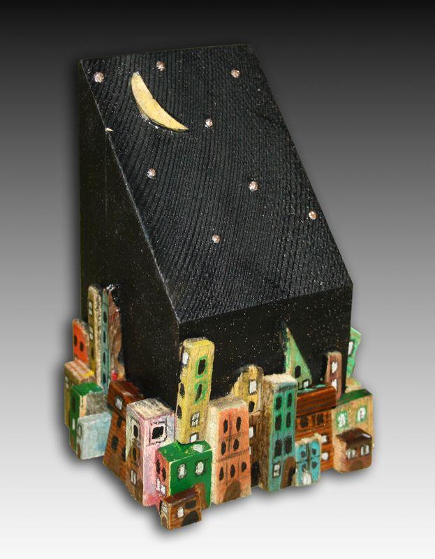 το πίσω μέρος από ένα πήλινο ρεσώ   ( το φεγγάρι και τα αστέρια ---> τρύπες)