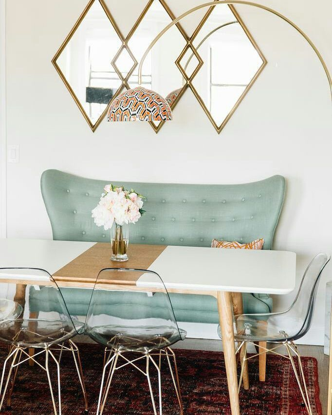 Adorable teal velvet bench plus acrylic Eiffel chairs and three diamond gold framed mirrors above a white dining table