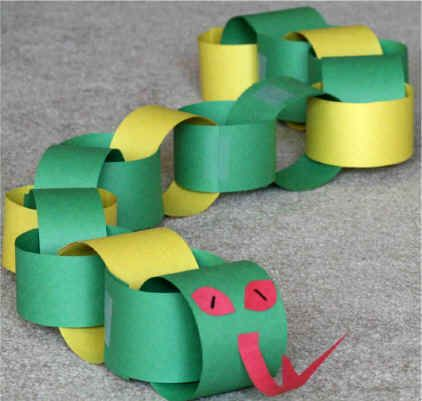 2013 will be year of the snake: simple construction paper chain and some embellishments complete this snake
