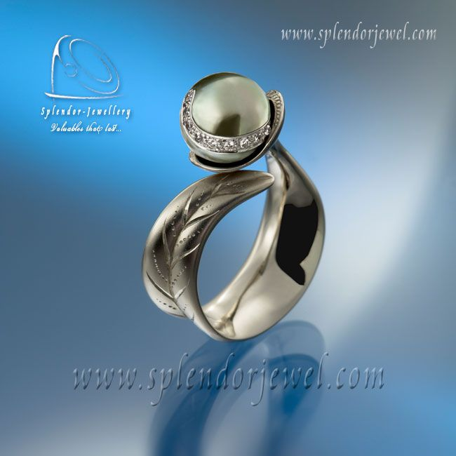 Awarded Tahitian pearl cocktail ring. White gold ring adorned with a perfect Tahitian pearl and a row of small brilliant cut diamonds.