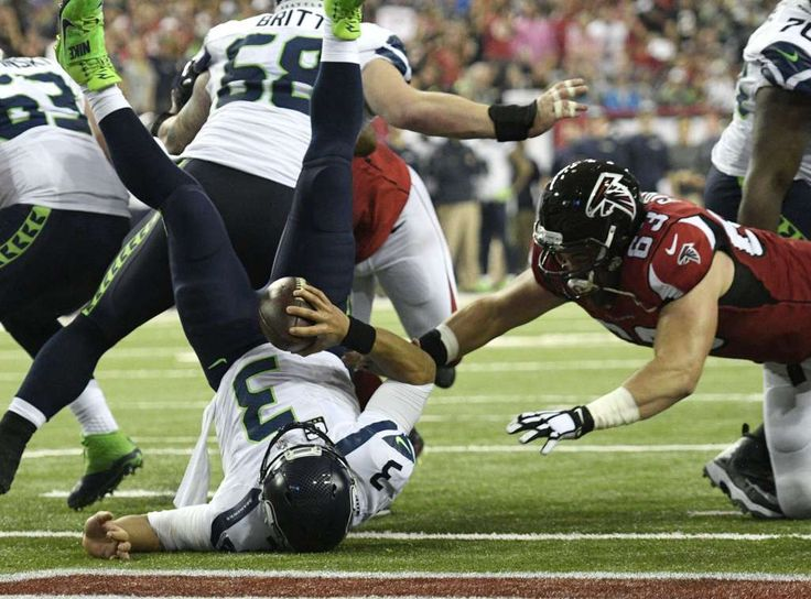 After a 3-yard loss by Thomas Rawls on first down, Odhiambo accidentally stepped on Wilson's foot as Wilson took the snap from center Justin Britt. The quarterback fell backward into the end zone, where he was touched down by the Falcons for a safety that made the score 10-9 Seattle with 11:20 left in the half. Photo: Dale Zanine/USA Today Sports