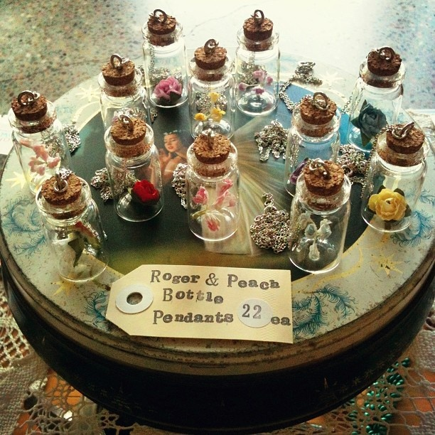 sweet #rogerandpeach flower-filled bottle necklaces...