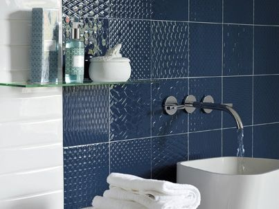 The calming influence of blue tiles will instantly refresh your tired bathroom!