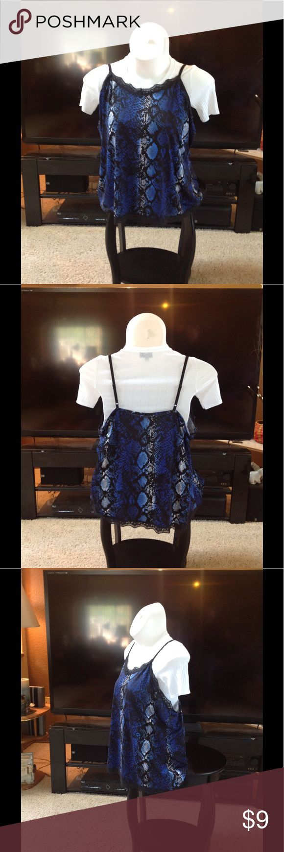 Black blue and white spaghetti strap tank Black blue and white animal print women's tank top. Spaghetti straps and black lace around the top and bottom. Made of 92% polyester 8% spandex. Runs a little short Fashion Bug Tops Tank Tops