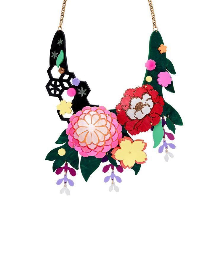 Kimono Bloom Statement Necklace - With influences stemming from Japanese textiles and the art of flower arranging, the Kimono Bloom Statement Necklace blossoms in an array of acrylic. A bold bouquet bursts from a geometric trellis and marbled green foliage, while floral motifs and cascading wisteria add a delicate touch to this structural design. This necklace features a Tatty Devine Limited Edition tag, is part of a numbered edition of 25 and comes with an exclusive certificate of…
