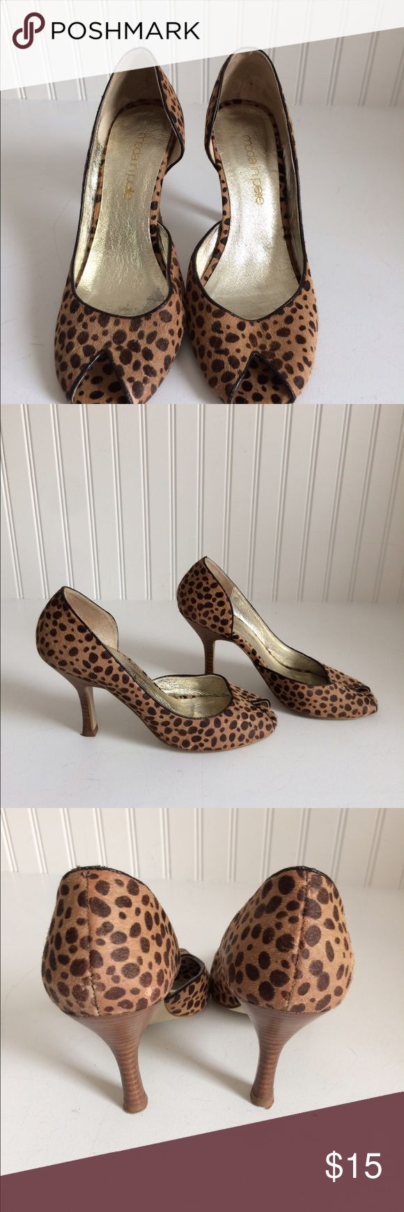 "Moda in Pelle animal print peep toe high heels 6 These super cute open toe Leopard print high heels do show some wear around the toes and the heel area. The wear is mainly mild fading . The sole shows sign of wear.   Size: 6 Heel Height:  3.5"" moda in Pelle Shoes Heels"