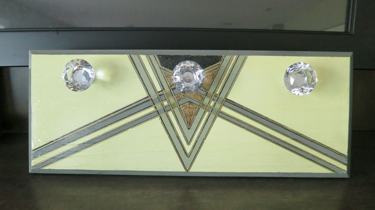 I love art deco so painted this design on a piece of pine.  Crystal  knobs were added.