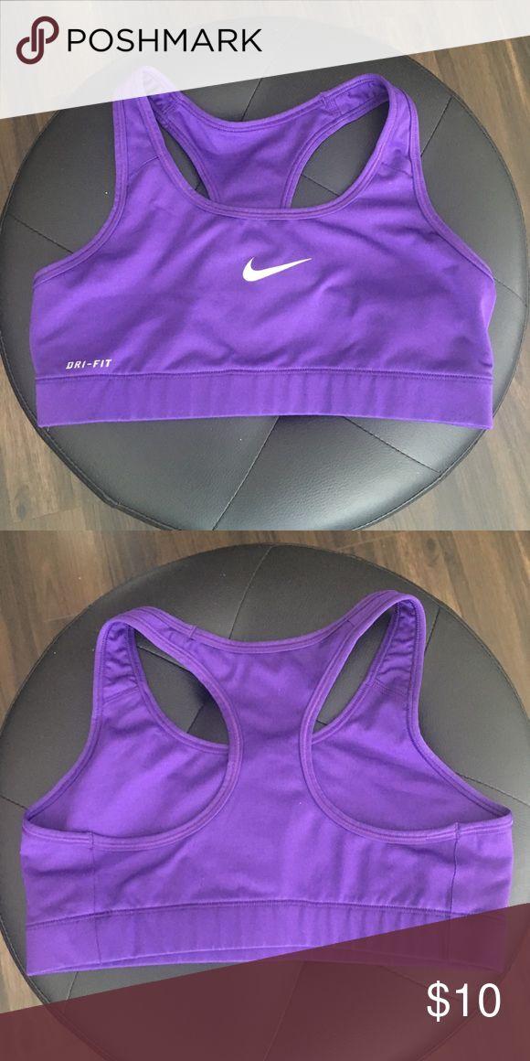 Nike Purple sports bra Gently Worn Nike Purple sports bra. Size tag was cut off but it's a size medium. In good condition. Nike Intimates & Sleepwear Bras