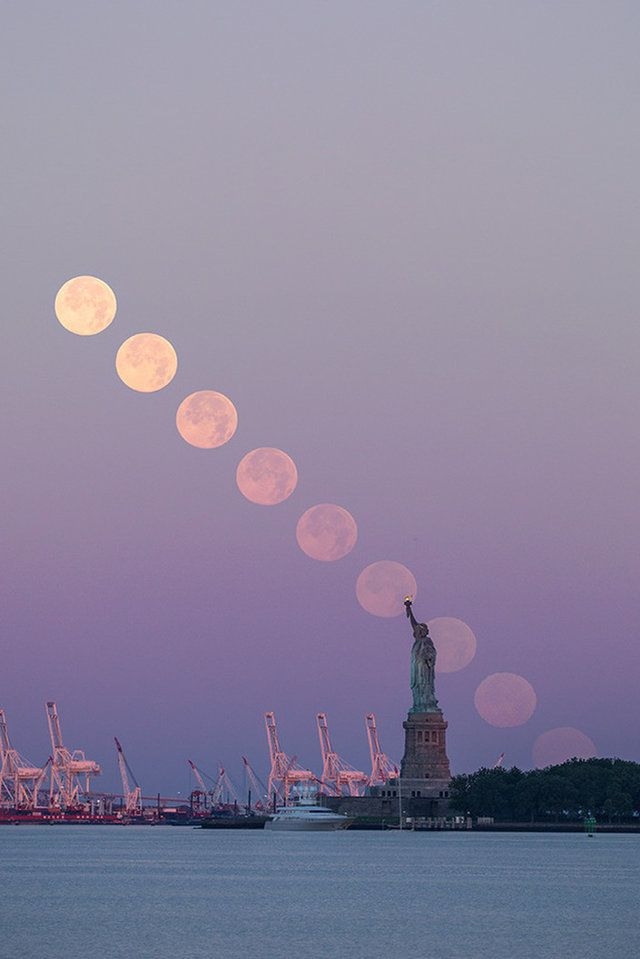 The full Thunder Moon sets behind the Statue of Liberty in New York City in this composite image taken on Sunday morning (July 9).