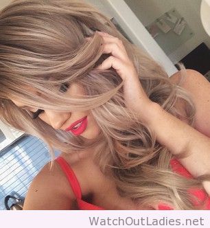 Gorgeous light brown hair with subtle blonde highlights.