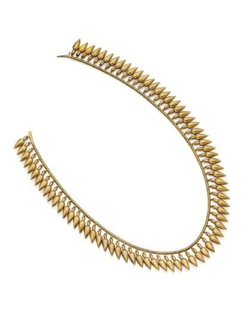 GOLD ARCHAEOLOGICAL-REVIVAL NECKLACE, CIRCA 1870. Decorated with a fringe of gold pendants styled as amphorae supported on a gold chain, gross weight approximately 42 dwts., length 16 inches.