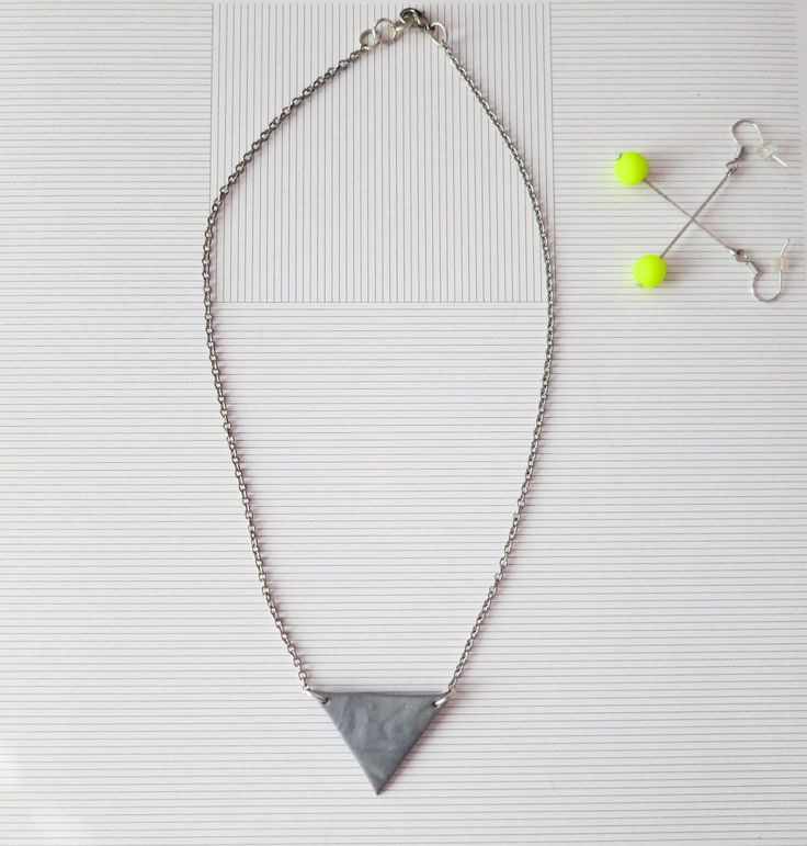 Triangle Necklace and Neon Earrings (Can´t be overlooked..)