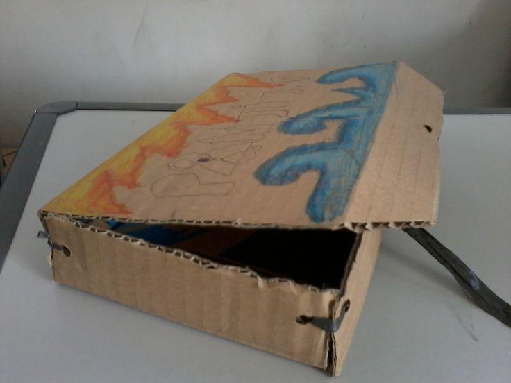 Panji's functional box. It's made of cardboard, crayon, and rafia fibre