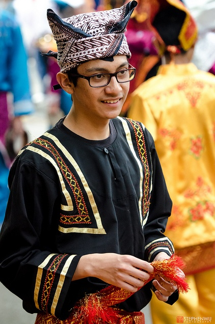 Indonesian youth in traditional garbs during Canada Day parade in Vancouver, celebrating multiculturalism.