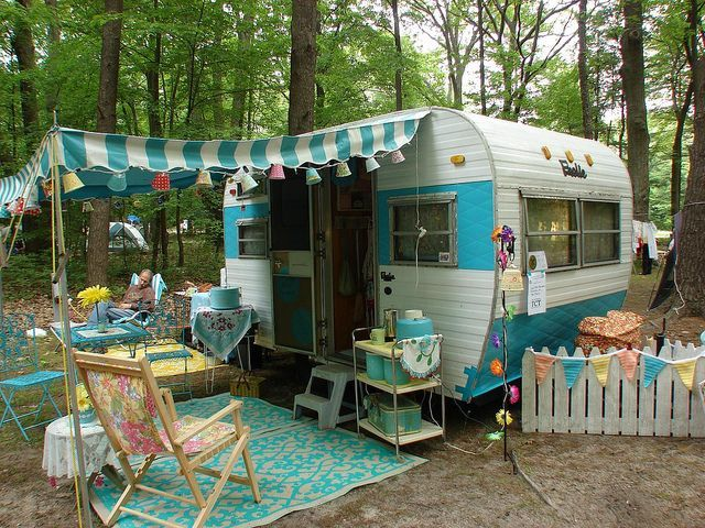 vintage turquoise travel trailer and outside decor