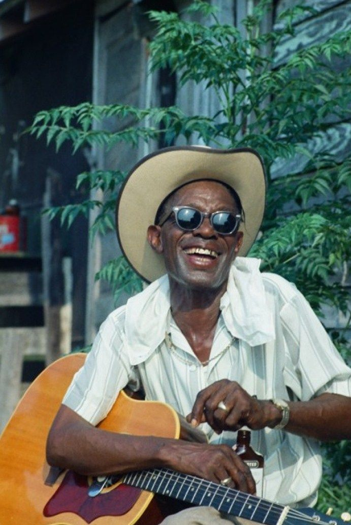 Lightnin' Hopkins …my favorite pic of Lightnin'. You can tell this guy loved to laugh as much as he like to play.